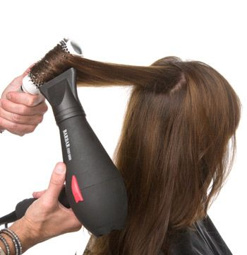 Blow dry the hair over a round brush.