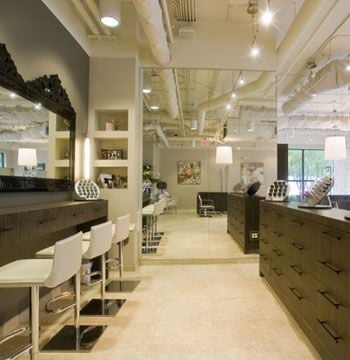 """""""To enhance our productivity and profitability we designed the bright light shelving in the reception area to highlight the retail products. We also designed the make-up area to be a main focus and we allow the clients to test make-up as they would in a department store."""""""