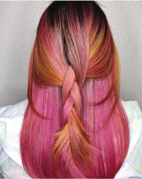 The pink and orange in this look work together harmoniously.
