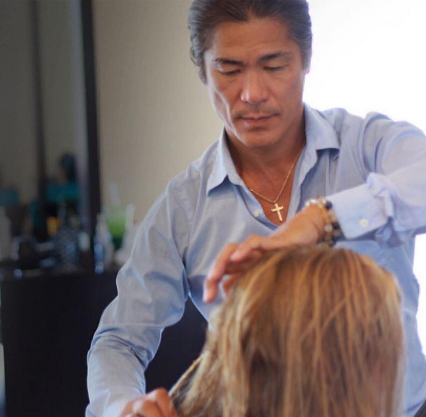 Master Hairstylist Katsumi Kasai cutting/styling hair.