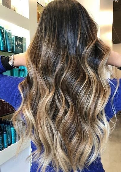 We love how this look still is light at the ends but embraces darker colors at the top and throughout. This is the perfect transition look or a way to keep summer alive all year.