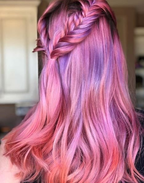 Everything about this look screams hair goals. The blend of pink and purple works well with the romantic braid.
