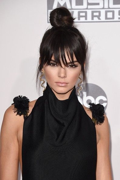 """Also debuting a dramatic """"cut"""" at the 2015 AMA's Kendall Jenner's new fringe """"grew out"""" quickly after its red-carpet debut that night."""