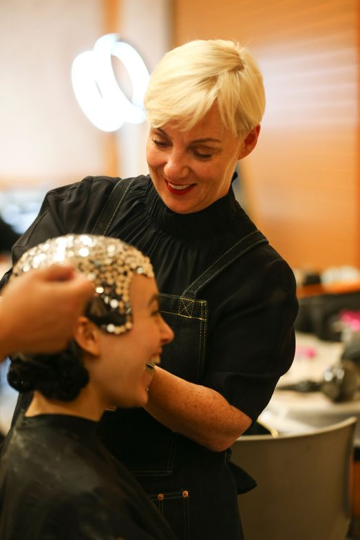 Aveda Global Creative Director <strong>Antoinette Beenders </strong>styles hair for Aveda's Liquid Life presentation at NAHA.<strong> <br /></strong>