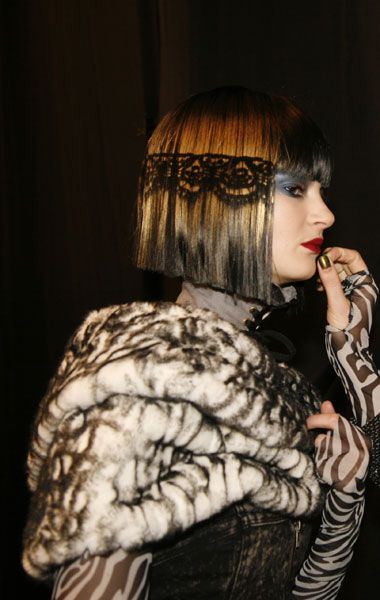 #12: Side view of laced hair, fake furs with laced effects.