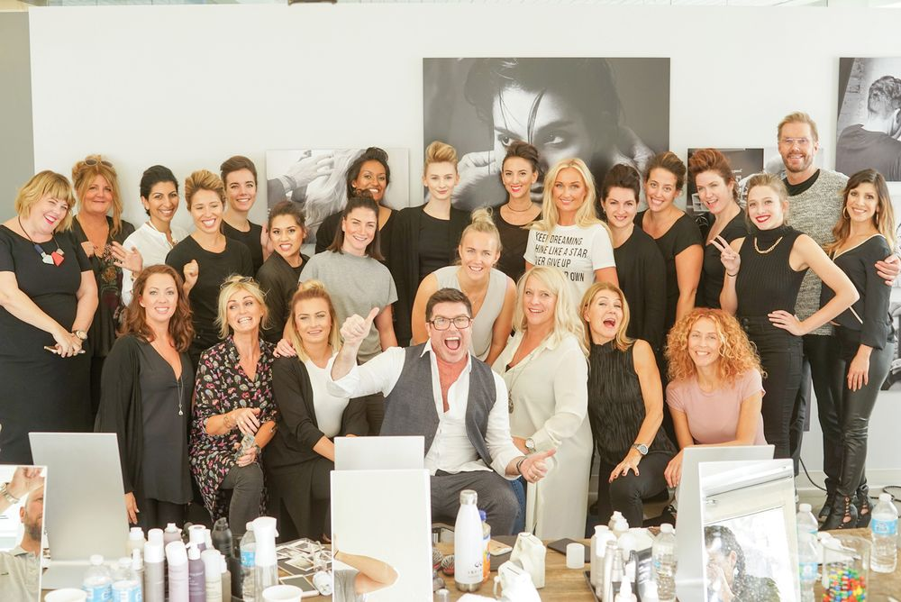 Michael Shaun Corby, Living Proof Global Creative Director, surrounded by Style Lab grads.