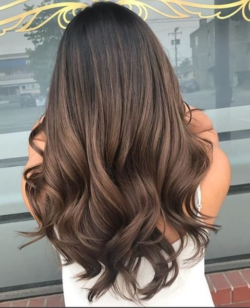 The brunette tone created here looks au naturale with a chic edge.