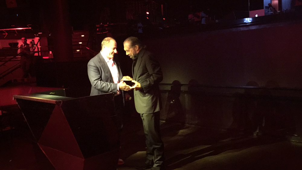 LBP co-founder and President Tev Finger presents award to John Paul DeJoria