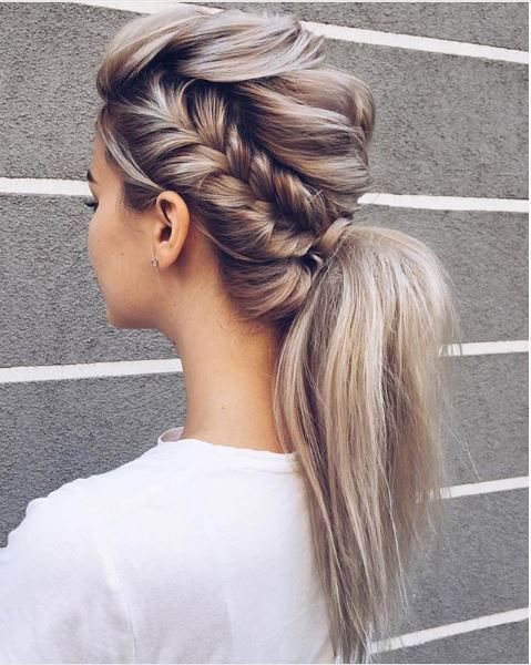 The intricacy of adding the side braid elevates this pony into chic territory.