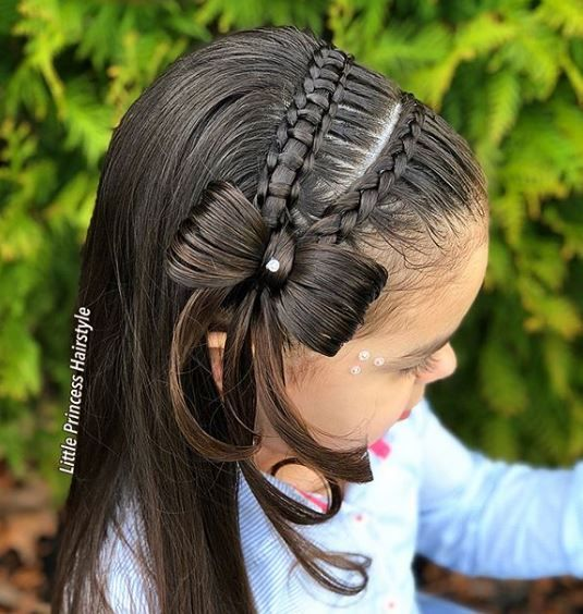 We think @little_princess_hairstyle did an awesome job with this beautiful braid and bow combo using the model's hair and some rhinestones for added pop.