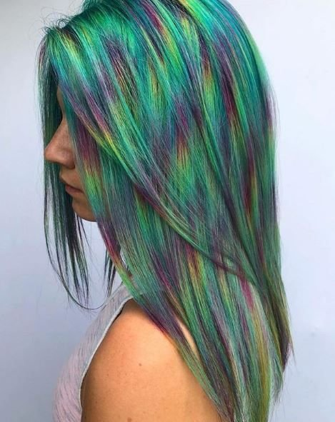 We can't get over how striking this hair color is, and green plays the main role.