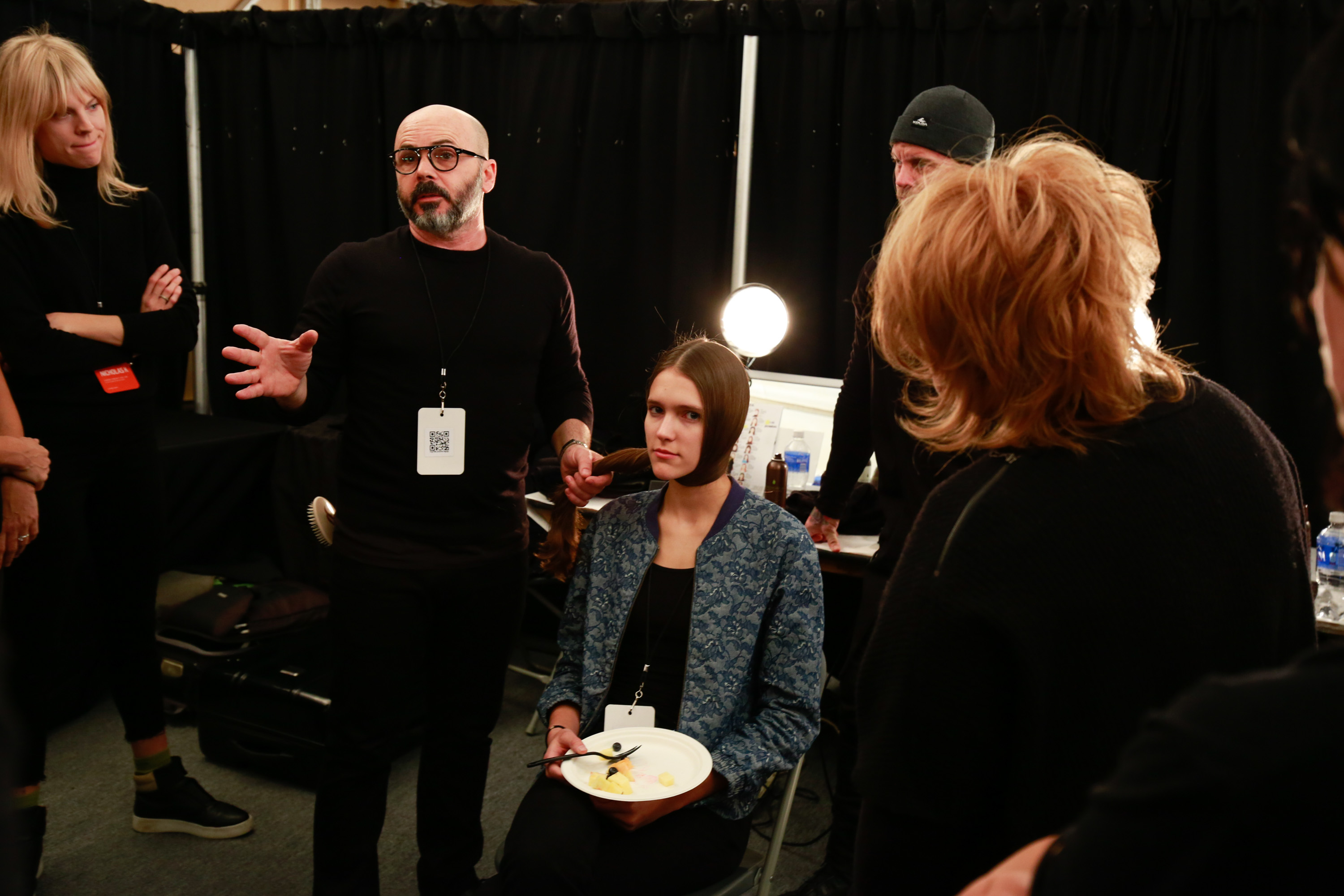 Giannandrea and members of the Macadamia Education Team discuss the finished look prior to the Nicholas K show at February 2016 NYFW.