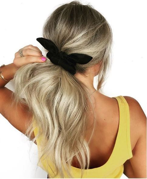 A simply scrunchie makes the pony look fun and laid back while still being fashionable.