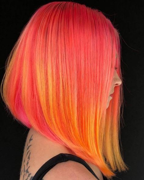 Talk about a power punch! We love this lava-colored lob and the way it catches the eye.