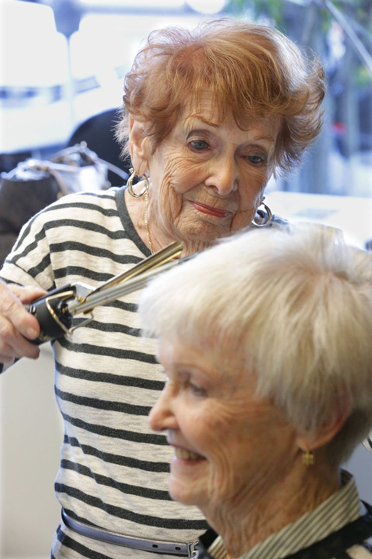 94-year-old Marion Stout, of Brigantine, left, curls the hair of Joan Mucciarone, of Margate, Friday Nov. 14, 2014, at Animations Salon in Ventnor City.  (photo credit: Michael Ein/pressofatlanticcity.com) Michael Ein/pressofatlanticcity.com