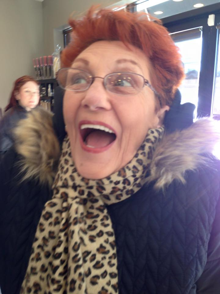 Martha, a client of Bamboo Salon in Staten Island, New York, reacts to the salon's new design.