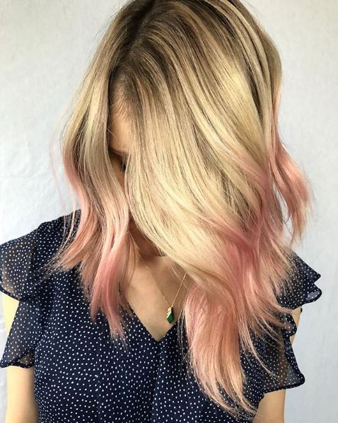 This lob is complemented with gorgeous pink ends to give it a fun and flirty feel.
