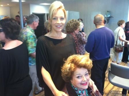 Lorraine Bruyelle stands behind her client, Pam Holloway, at the salon reopening.