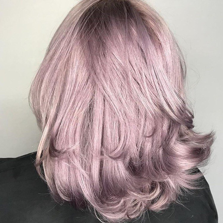 For this look, @bristen_arcs did a growth touch up with a blue oil lightening system and 20 Vol, pretoned on damp hair with 10V of the Demi and applied Lavender on dry hair and processed for 25 minutes.