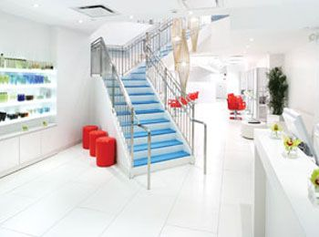 "<b>Judges comments:</b> ""The red literally pulls you to the styling station, while the cobalt staircase transcends."" — Cicela ""The lighting is the best feature here, including the backlit stations and the efficient, ambient lighting with many reflective materials to add to this sharp minimalist palette."" — Soukhopalov"