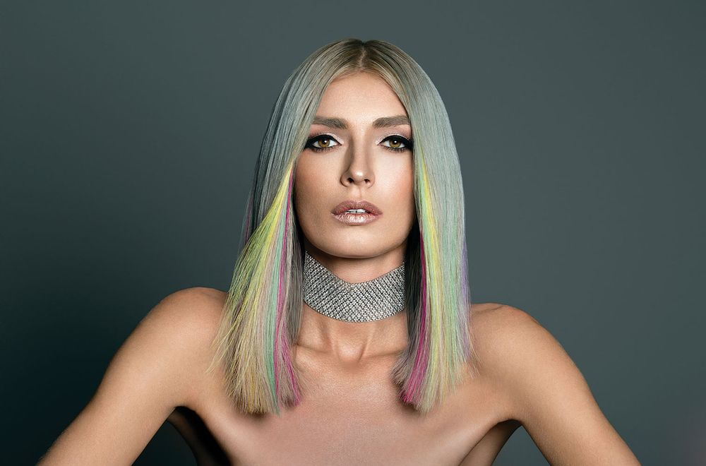 """""""I wanted to do something I hadn't done before by showcasing extensions in a brightly colored, full lob, because extensions go way further than just length.""""<br />—Victoria Casciola, Hotheads Artistic Director"""