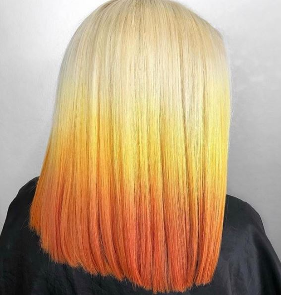 Is it just us or is this style so yummy it reminds you of candy corns? The beautiful transition of colors gives depth to the blunt cut.