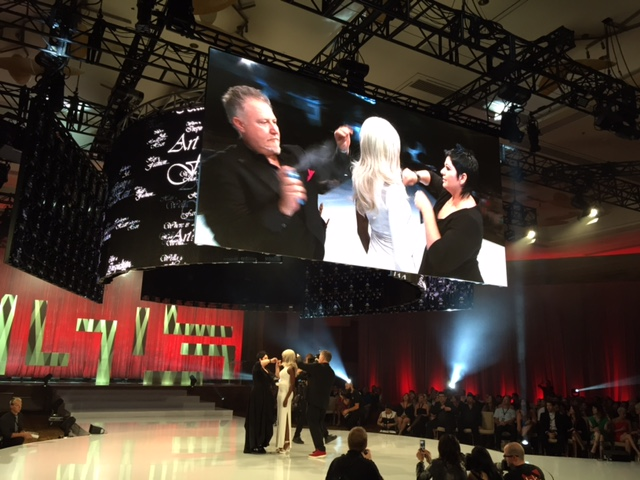 A surprise! Fabio Sementilli, Vice President of Education, and Carole Protat, P&G Salon Professional Education Director, transform a model on stage.
