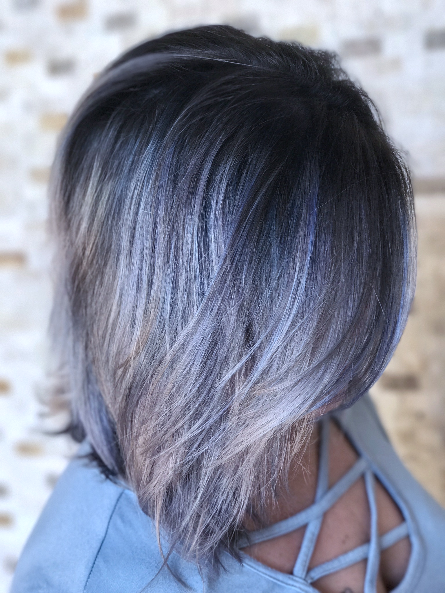 """""""The smokiness of the Joico Metallics collection really toned out any brass and left us with a gorgeous deep root into a more silvery blue at her ends."""""""