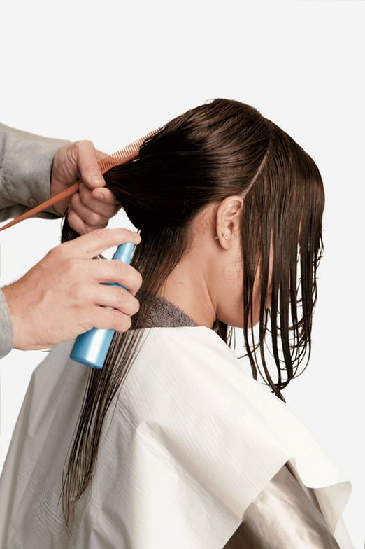 1. After shampooing with Sleek Shampoo, rinse and towel dry, then part hair into four sections. Spray Opti.smooth Pre-Treat onto ½-inch partings, scalp to ends.