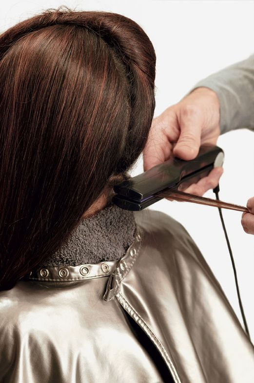 6. Apply Sleek Iron Smoother, section hair into quadrants. Beginning at nape, take a thin horizontal parting, iron the section three times until it is silky, shiny and no longer feels coated. Repeat through entire head.