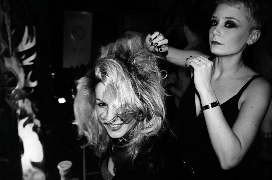 Hairdressers from NYC salons collaborate to style audience members stage-side at the Oribe Pop-Up Salon.
