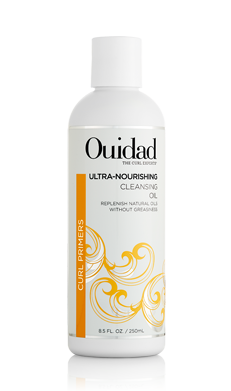 Ouidad's Cleansing Oil is an ultra-rich healing formula with an advanced oil base that gently removes dirt and build-up while restoring essential moisture. This foaming Cleansing Oil wraps delicate curls in the proprietary, nutrient-rich CR-4 Repair» complex, a cushiony coating of concentrated fatty acids that helps nourish, rebuild and protect curls in need of repair. Silk proteins and coconut oils bind to the cuticle for lasting hydration and renewed body and shine. For more information, visit www.ouidad.com.