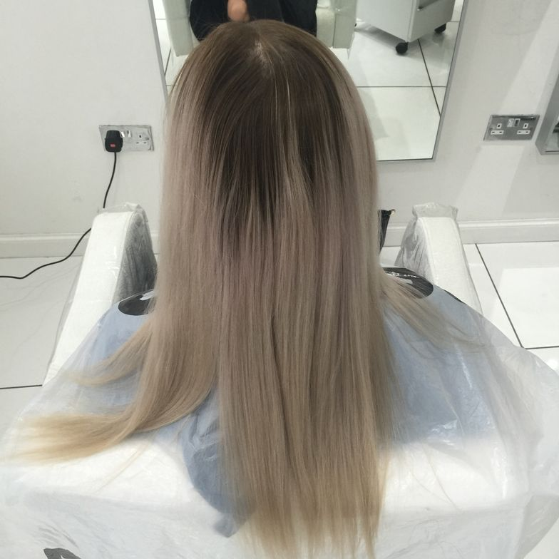 My model had a grown out level 5 shadow root and around a level 7 natural base with around a level 9 overly toned blonde mids and ends.  I knocked out the band first with Schwarzkopf Blond Me and 6% (20 volume) for around 25 minutes.  Apply the same mix to the roots for 10 minutes under a cap to insulate.