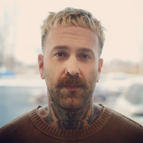 The Quebec, Canada-based salon owner, international barber and educator rocks a signature look...