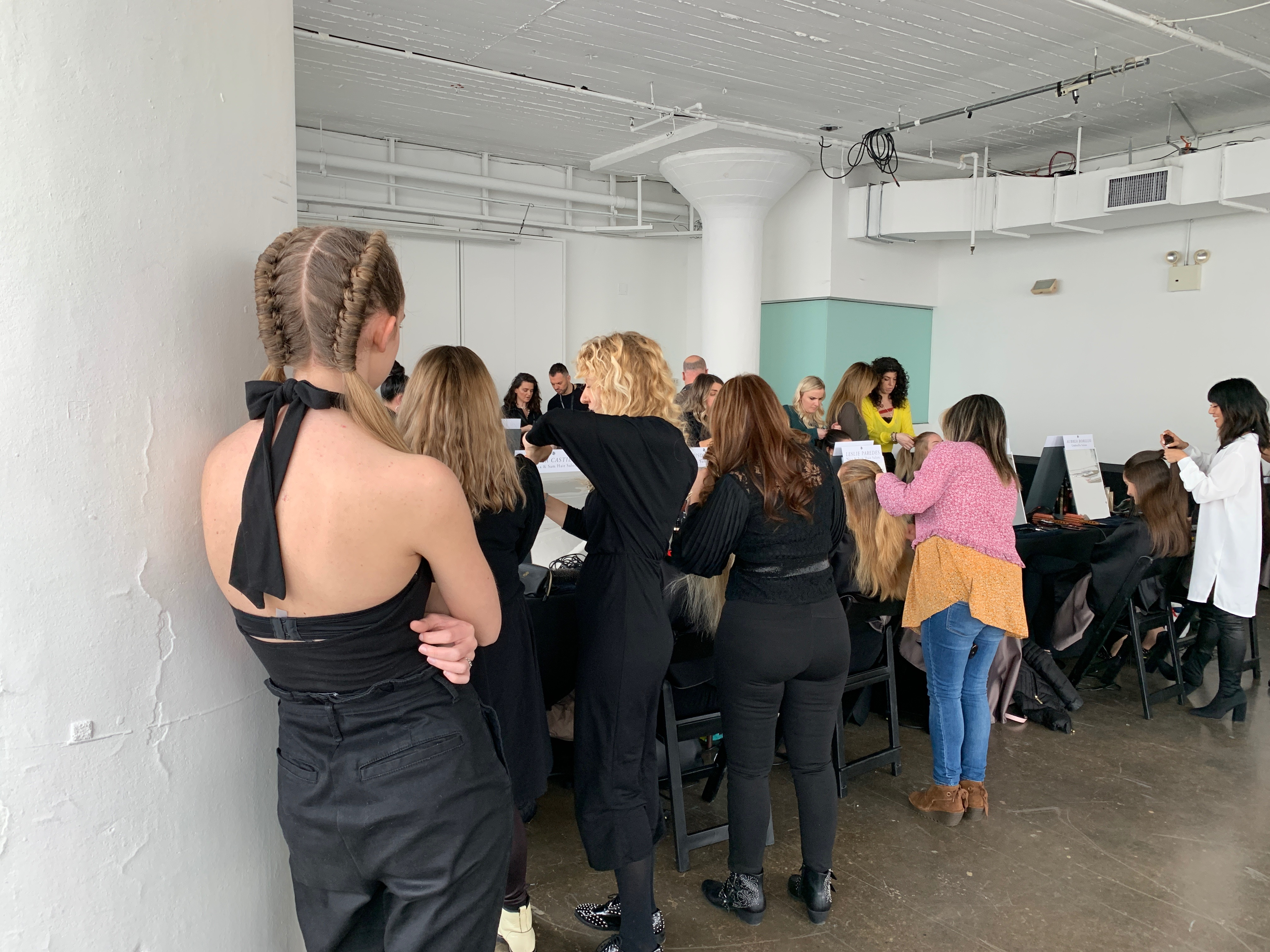 Nicci Welsh helps out during this Oribe workshop.