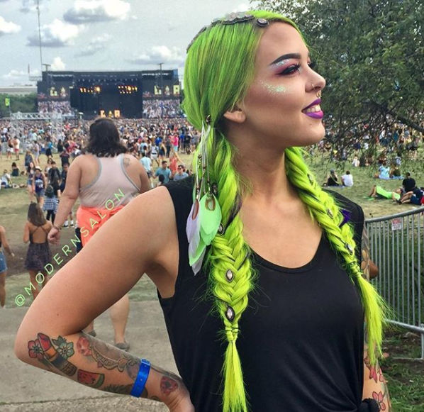 Kayla Boyer with braids by @annette_updo_artist with the festival as her backdrop.