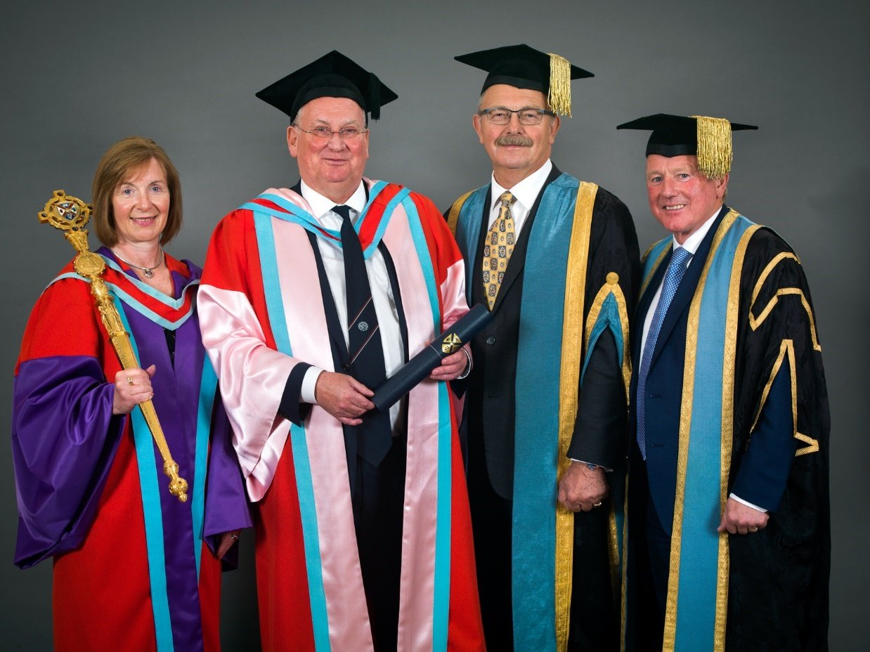 John Rainey (second from left) receiving his honorary doctorate with members of Queen's University in Belfast, Northern Ireland. Photo courtesy of Denman International.