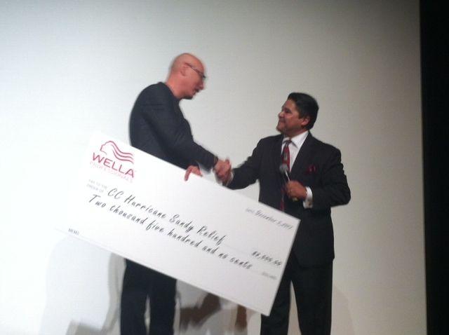 Wellas Reuben Carranza donates $2500 to CCs Joseph Cartagena for Hurricane Sandy Victim relief.