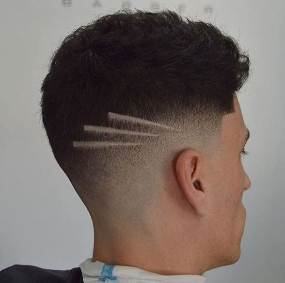 An edgy style doesn't have to be crazy, and this fade from @rm_barber proves that. The simplicity of the three diagonal lines creates a unique look without going overboard.