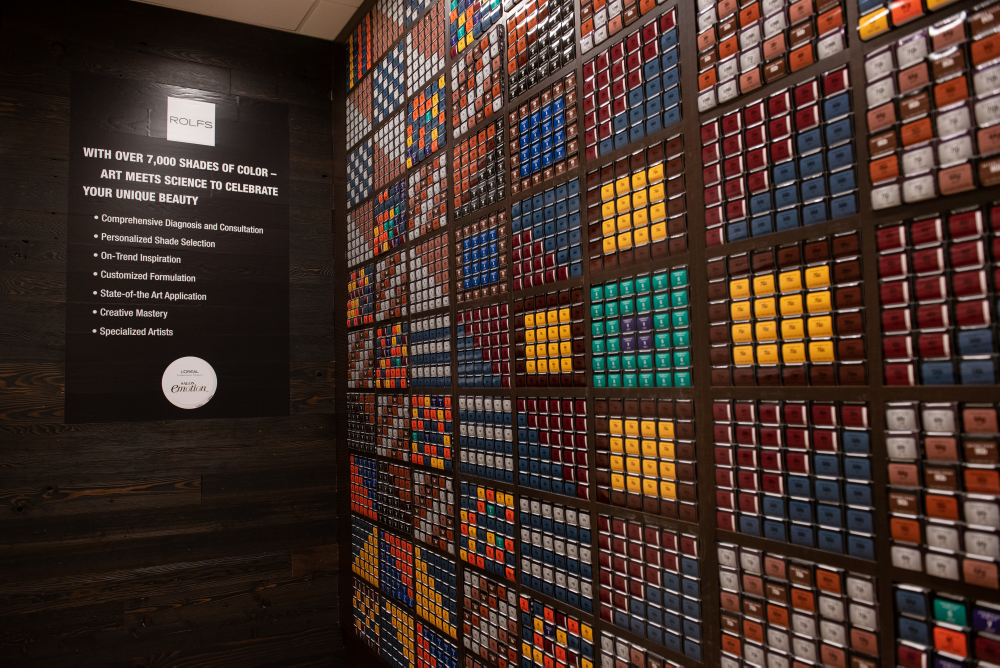 <p>Art meets science with a mosaic wall of color created from color boxes.</p>