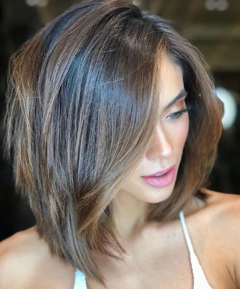Who says you need long length to have bombshell volume? This elevated style proves that lobs can be full and sassy, too.