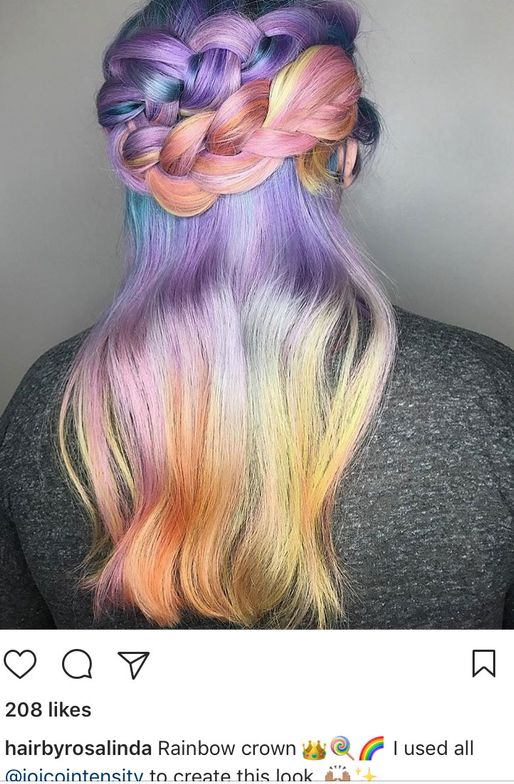<p>Via @hairbyrosalinda. This artist used all Joico Intensity color for this look, and we have to say that a braided crown was the best way to finish the look.</p>