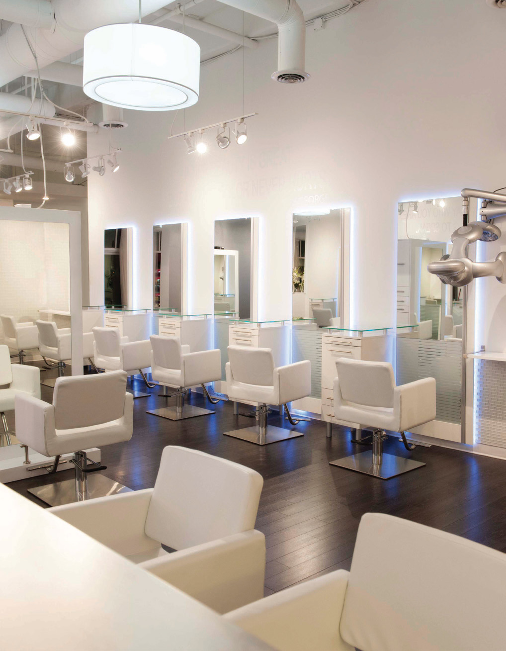 In Woodstock, Georgia, Salon Gloss' white decor provides the perfect canvas for the salon's artists to create fabulous hair.