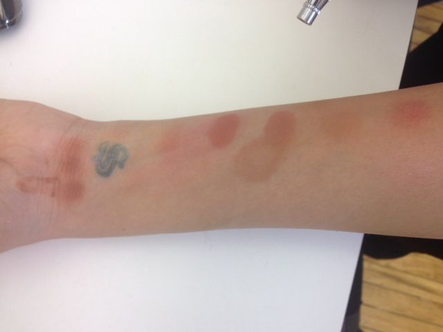 Sasha Marie tests color on her arm