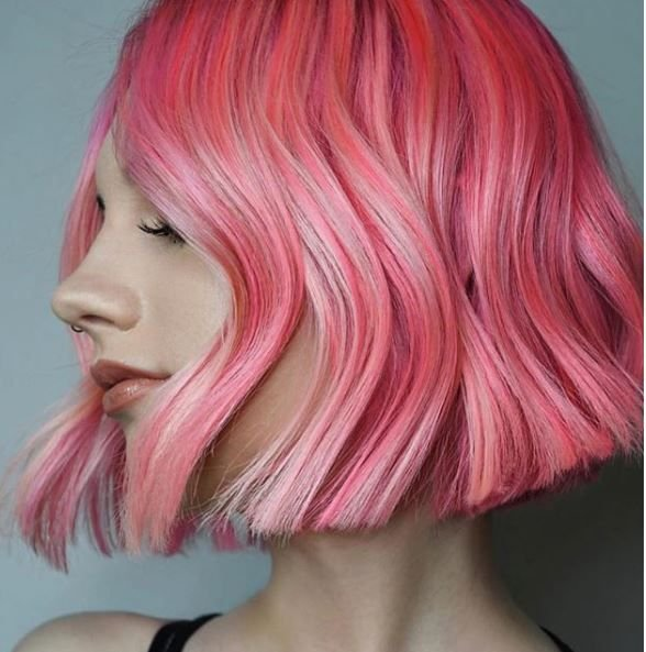 The edgy cut paired with the taffy pink color and wave make this ultra cool.
