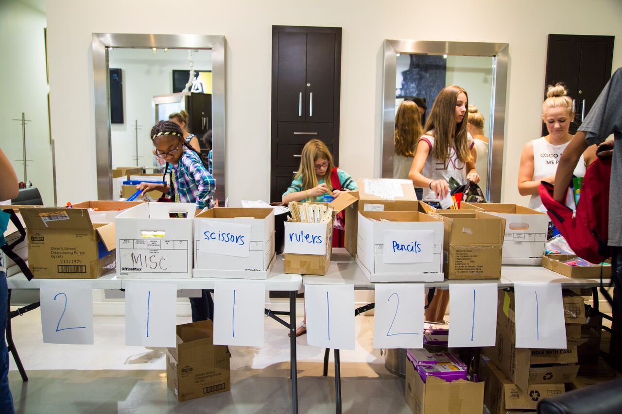 Children pick out donated school supplies at Square Salon's back to school event benefitting CASA.  (photo credit: Square Salon) Square Salon