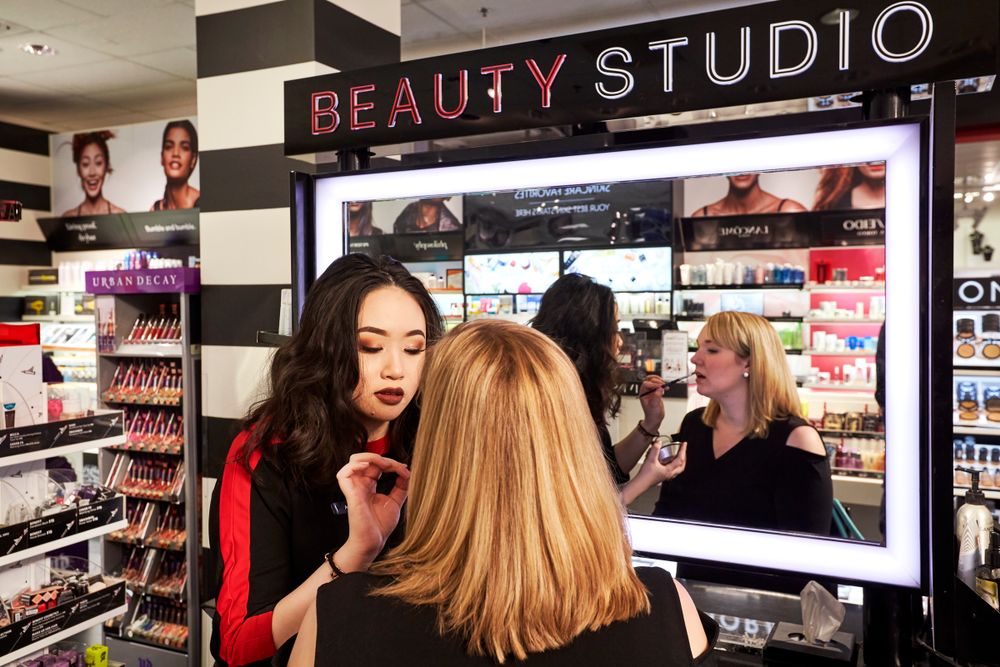 A shopper take a moment for a makeup application at Sephora inside JCPenney.