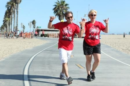 Artistic Director Rafe Hardy (left) logs the miles and raises the money.