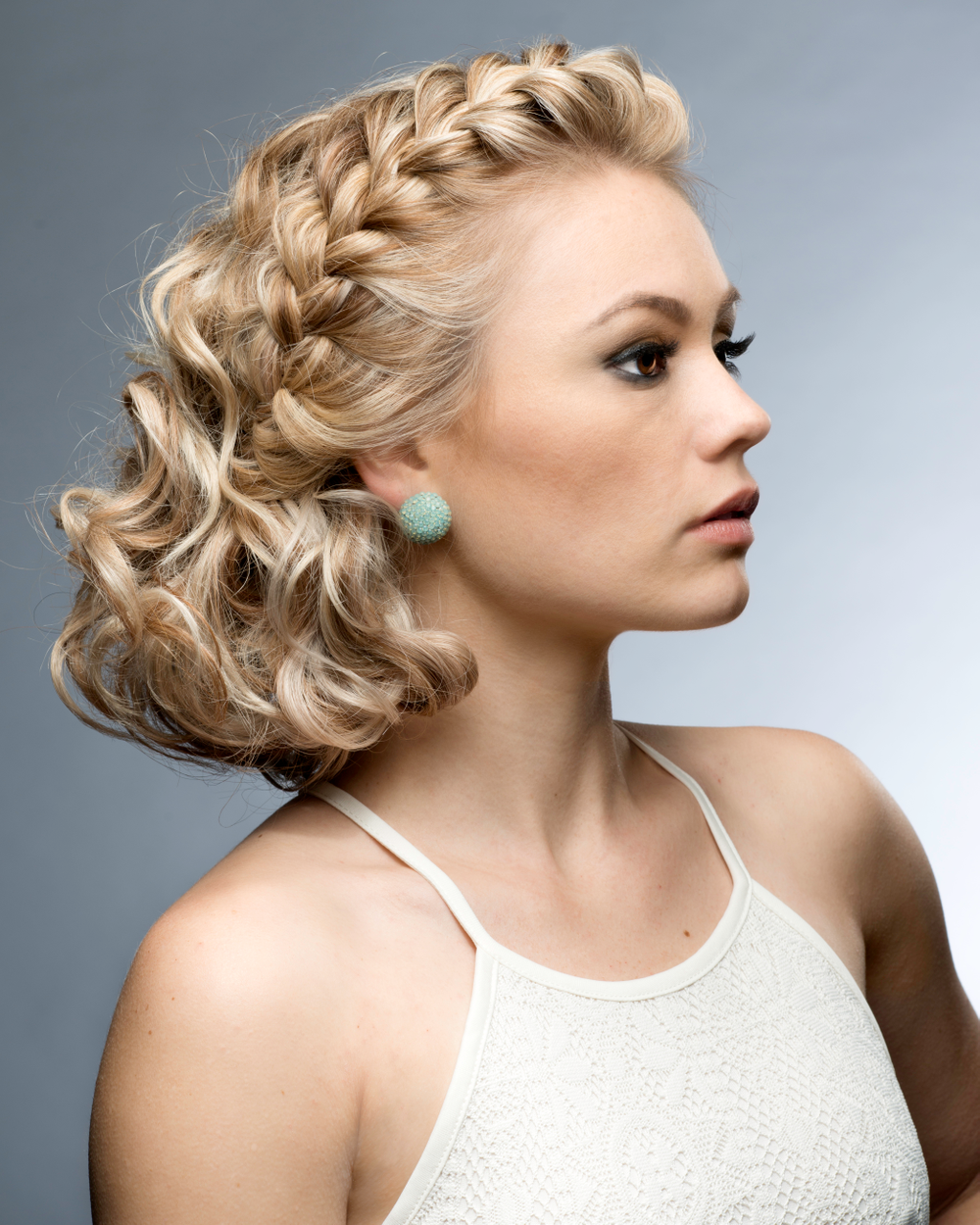 Braids, sometimes glamorous, sometimes exotic and intricate but never go unnoticed. Whether elegant, chic, organic or edgy, you can dress them up or dress them down to match your mood. Carley's braided updo accentuates her maturity and confidence while at the same time displaying her youthful exuberance.