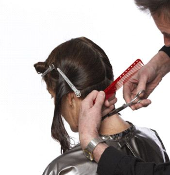 Begin with the cut at the nape. Hold down and cut straight across to desired length.